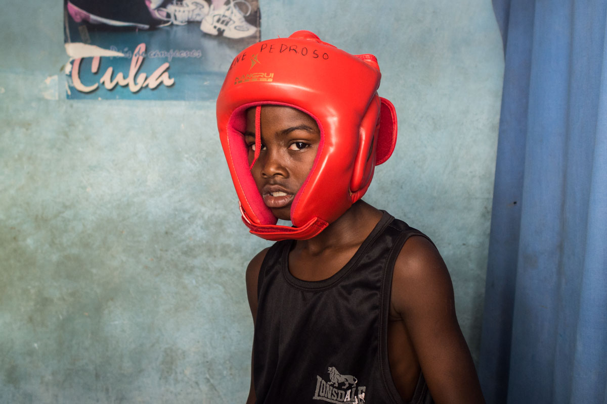 cuban photographer in a portrait session in a boxing cuban gym