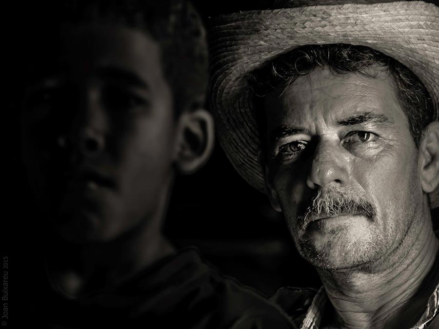 Father and son in a portrait black and white in vinales the country side of cuba