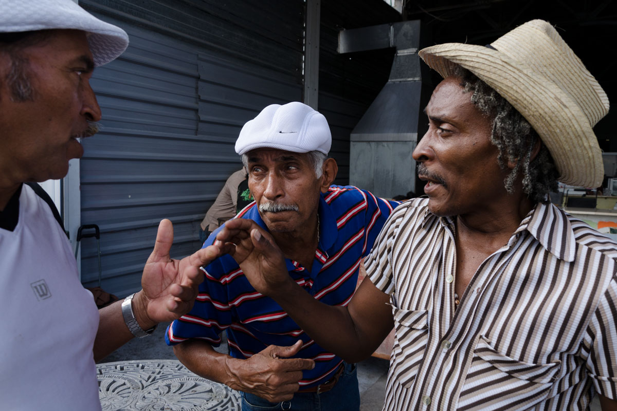 three cubans speaking really close, photo taken in a photo tour by Louis Alarcon