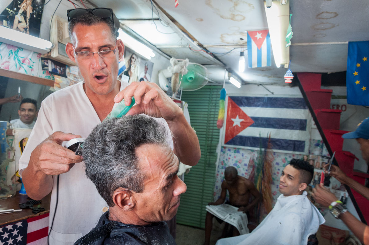 photography of a barber shop in Havana by louis Alarcon