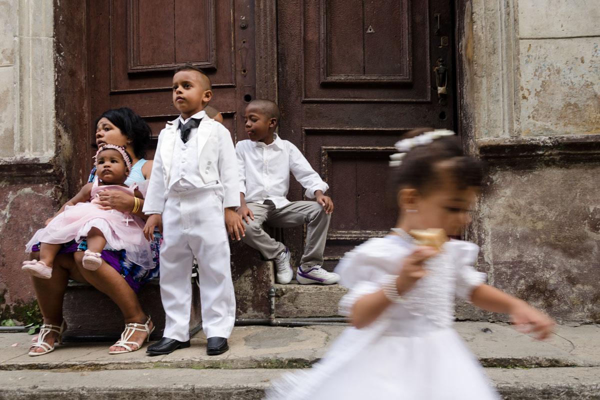 cuban children dress in white in a wedding in havana, street photography style in havana, cuba