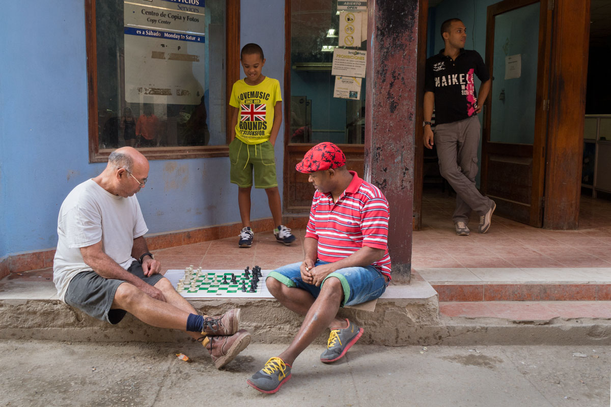 playing domino in havana, street photography focus in cuban life