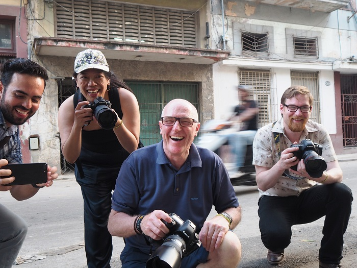 photographers smiling practising street photography in Havana streets with cuban photographer louis alarcon