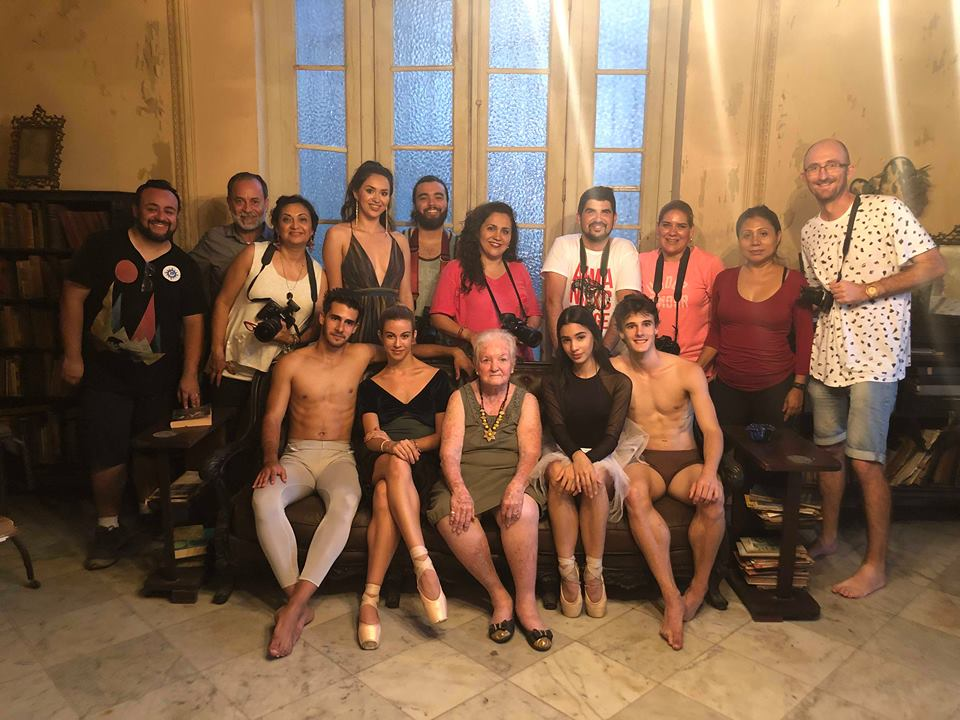 group of photographers in a colonial old house in havana