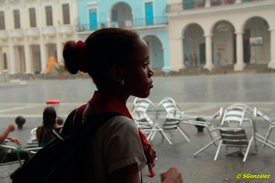 school girl in a rainy day waiting