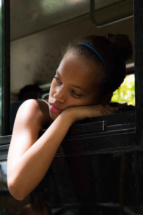 little cuban girl resting in the window of a bus in my city photo tour in havana