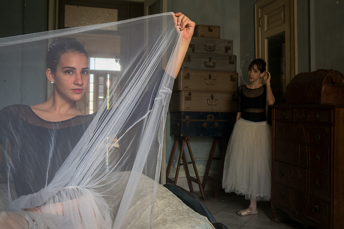 ballet dancers in colonial houses in havana , cuba
