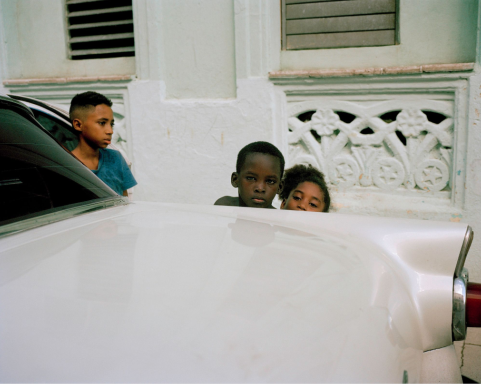 cuban boys in the street by Colby Tarsitano