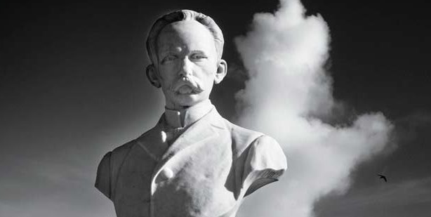 statue of jose marti with a cloud behind him by cuban photographer alfredo sarabia