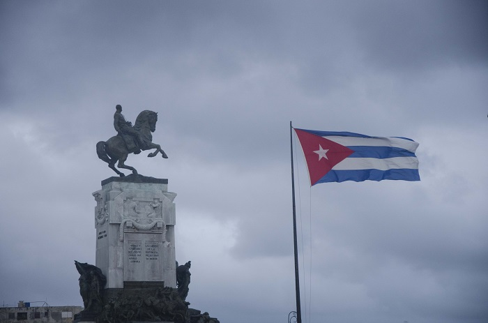 Maceo statue with cuban flag in havana, a urban landscape picture
