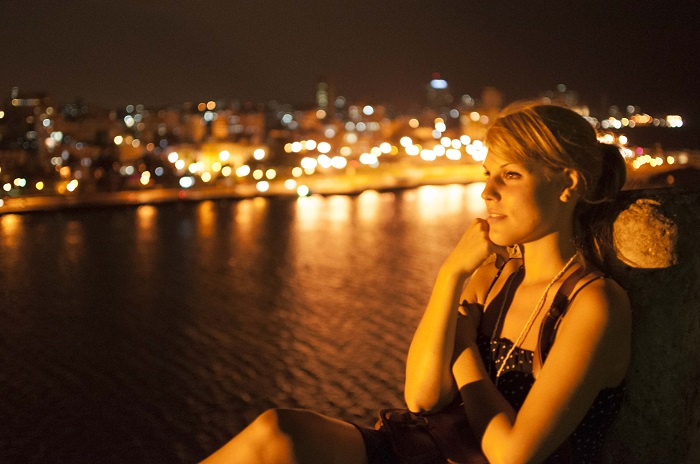 portrait in havana at night with the city as background